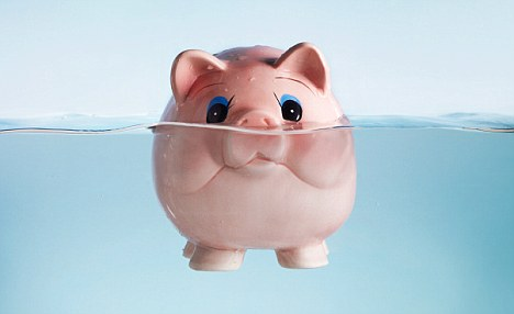 sinking, floating, piggy bank, money worries, drowning