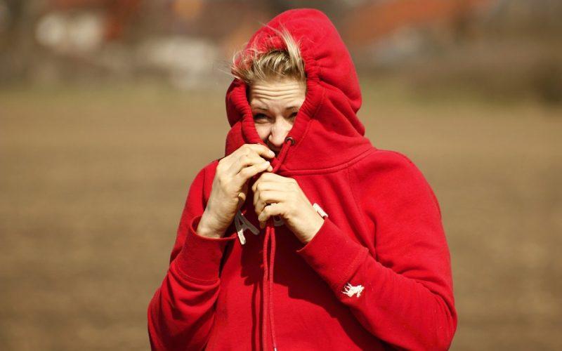 anxious woman, confrontophobic, worried, hiding