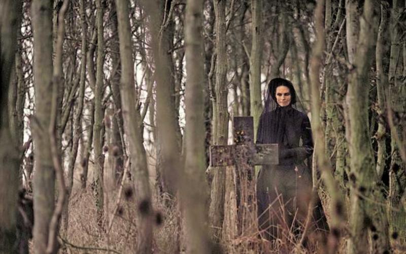 woman in black, leanne best, funeral, secret, shifty, suspicious, black, grave